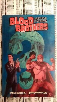 Blood Brothers Hermanos De Sangre TPB Graphic Novel (Signed + Bookmark & Patch)) • 2£